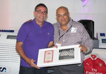 David Schiller from Max's Foundation hands out an auction prize